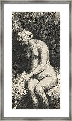 Woman Bathing Her Feet At A Brook Framed Print by Rembrandt