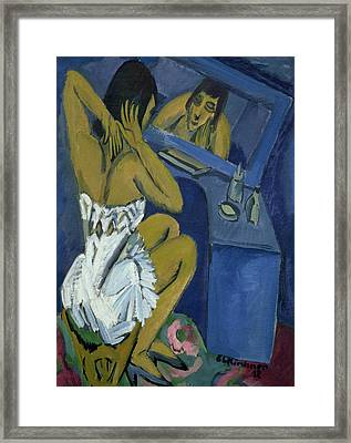 Woman Before The Mirror Framed Print by Ernst Ludwig Kirchner