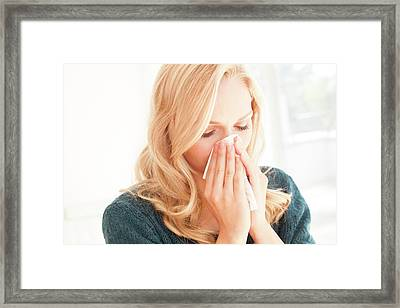 Woman Blowing Nose With Tissue Framed Print