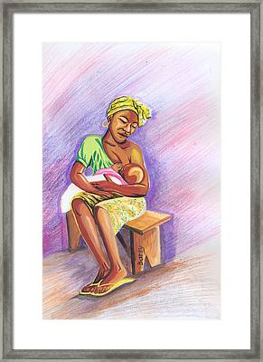 Woman Breastfeeding Bay In Rwanda Framed Print