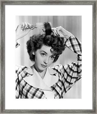 Woman Brushing Curls In Her Hair Framed Print