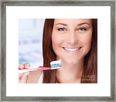 Woman Brushing Her Teeth Framed Print