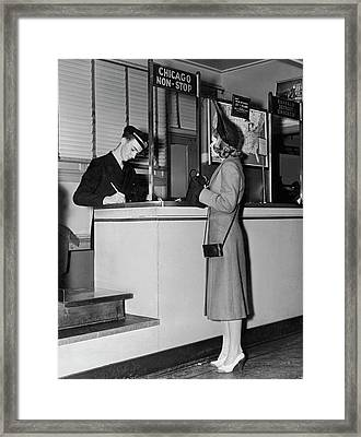 Woman Buying A Plane Ticket Framed Print