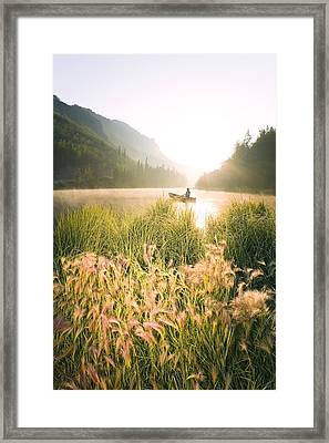 Woman Canoeing On Long Lake In Early Framed Print by Michael DeYoung