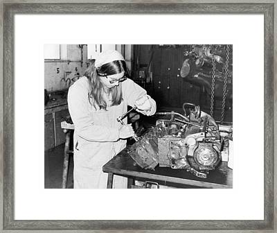 Woman Car Mechanic Framed Print by Underwood Archives