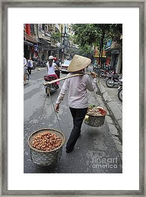 Woman Carrying Baskets Of Fruits Framed Print