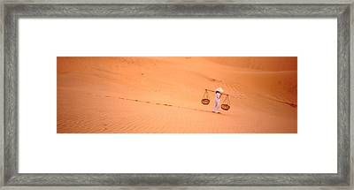Woman Carrying Panniers, Mui Ne, Vietnam Framed Print by Panoramic Images
