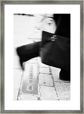 woman carrying shopping bag walking over double row of bricks across berlin to mark the position of the berlin wall berliner mauer Berlin Germany Framed Print