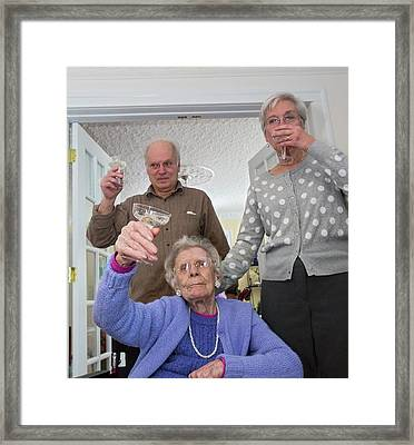 Woman Celebrating 100th Birthday Framed Print by Jim West