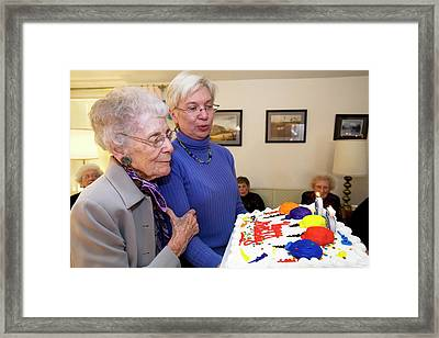 Woman Celebrating Her 95th Birthday Framed Print by Jim West