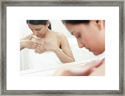 Woman Checking Her Breasts Framed Print