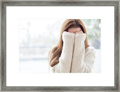 Woman Covering Face Framed Print by Ian Hooton