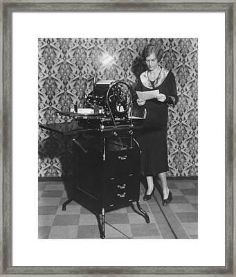Woman Demonstrates Duplicator Framed Print