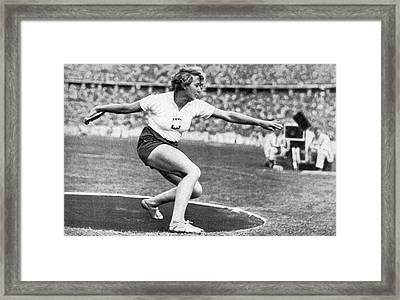 Woman Discus At 1936 Olympic Framed Print by Underwood Archives