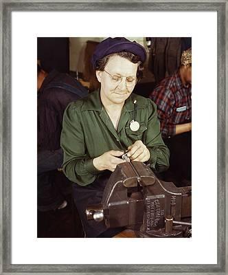 Woman Doing Bench Work On Small Gun Framed Print by Stocktrek Images