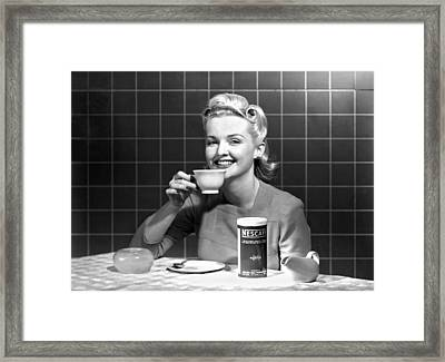 Woman Drinking Nescafe Framed Print by Underwood Archives