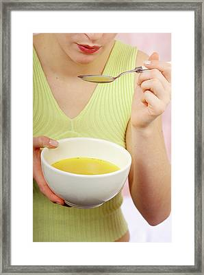 Woman Eating Soup Framed Print by Lea Paterson/science Photo Library