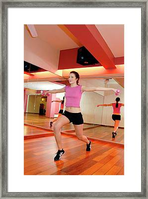 Woman Exercising In A Gym Framed Print by Aj Photo/science Photo Library