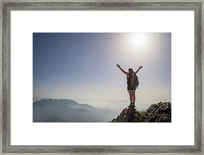 Woman Exulting On A Mountaintop Framed Print by Buena Vista Images