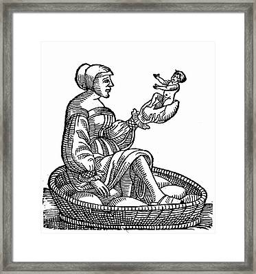Woman Hatching A Baby From An Egg Framed Print