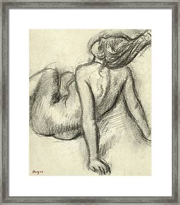 Woman Having Her Hair Styled Framed Print by Edgar Degas