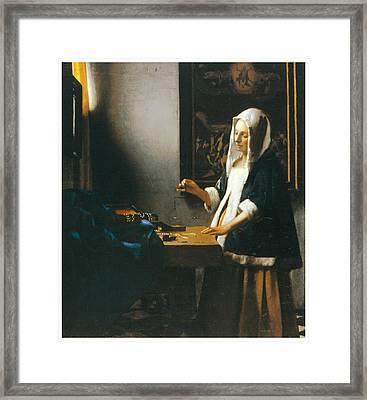 Woman Holding A Balance Framed Print by Johannes Vemeer