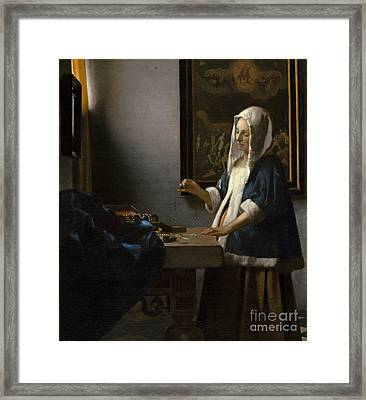 Woman Holding A Balance Framed Print by Celestial Images