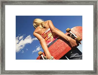 Woman Holding A Skateboard Framed Print