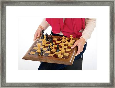 Woman Holding Chess Board Framed Print by Lea Paterson