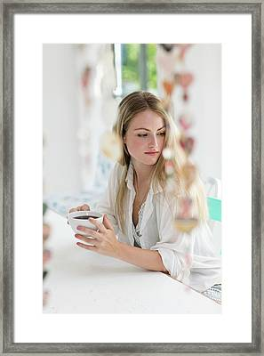 Woman Holding Coffee Cup Framed Print by Science Photo Library