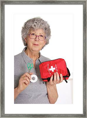 Woman Holding First Aid Kit Framed Print