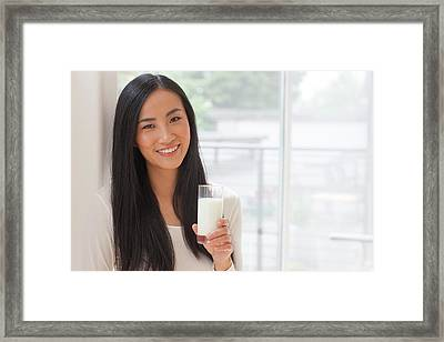 Woman Holding Glass Of Milk Framed Print by Ian Hooton