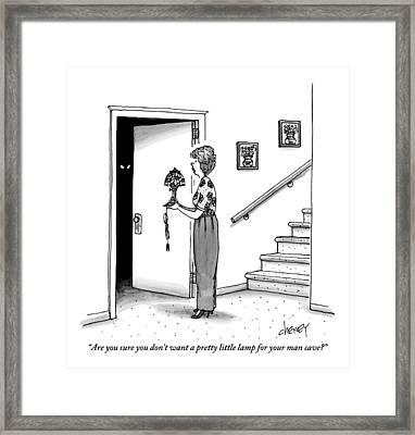 Woman Holding Lamp Stands At Dark Bedroom Doorway Framed Print
