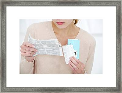 Woman Holding Medication Framed Print