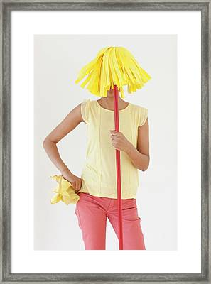 Woman Holding Mop In Front Of Face Framed Print by Ian Hooton