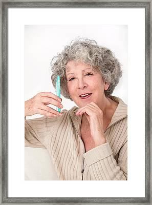 Woman Holding Smartphone Framed Print