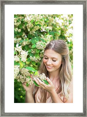 Woman Holding White Flowers Framed Print by Ian Hooton/science Photo Library