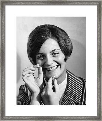 Woman Holds Integrated Circuit Framed Print by Underwood Archives