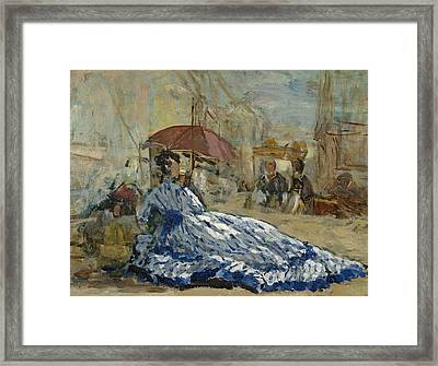 Woman In A Blue Dress Under A Parasol Framed Print by Eugene Louis Boudin