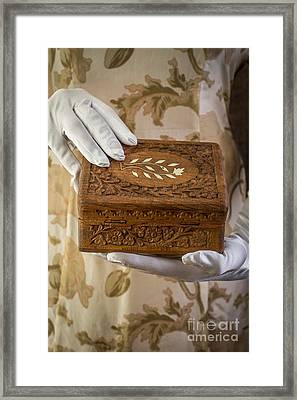 Woman In A Dress Opening A Ornate Box Framed Print