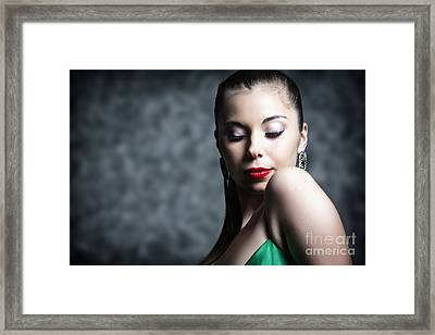 Woman In Make Up With Hair Tied Back And Green Dress Framed Print by Joe Fox