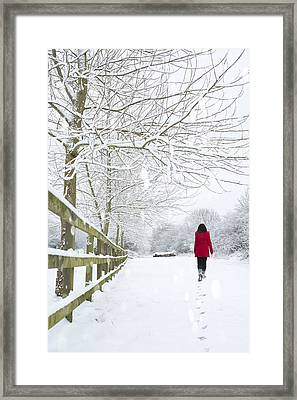Woman In Red Coat Framed Print by Amanda Elwell