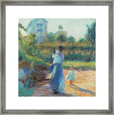 Woman In The Garden Framed Print