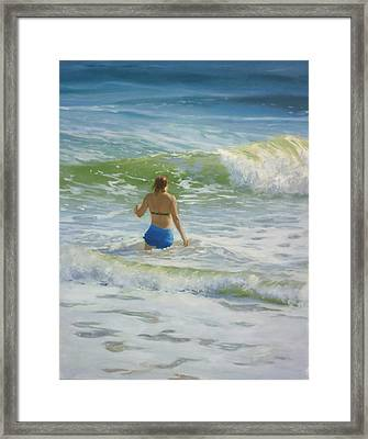 Woman In The Waves Framed Print