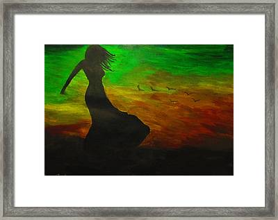 Woman In The Wind Framed Print by Haleema Nuredeen