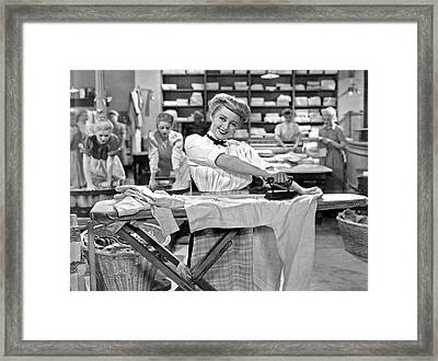 Woman Ironing In Laundry Framed Print