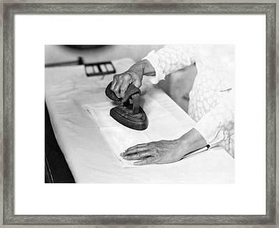 Woman Ironing With Flat Iron Framed Print by Underwood Archives