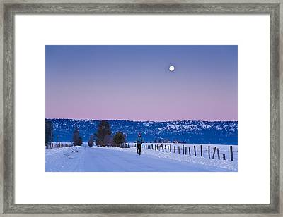 Woman Jogging In Winter On Rural Road Framed Print