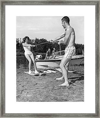Woman Learning To Water Ski Framed Print