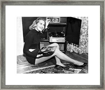 Woman Listening To Records Framed Print by Underwood Archives